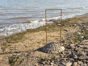 WINDOW to the SEA, metal frame and rocks, Ste-Marie St-Raphael, NB, Canada - 2015
